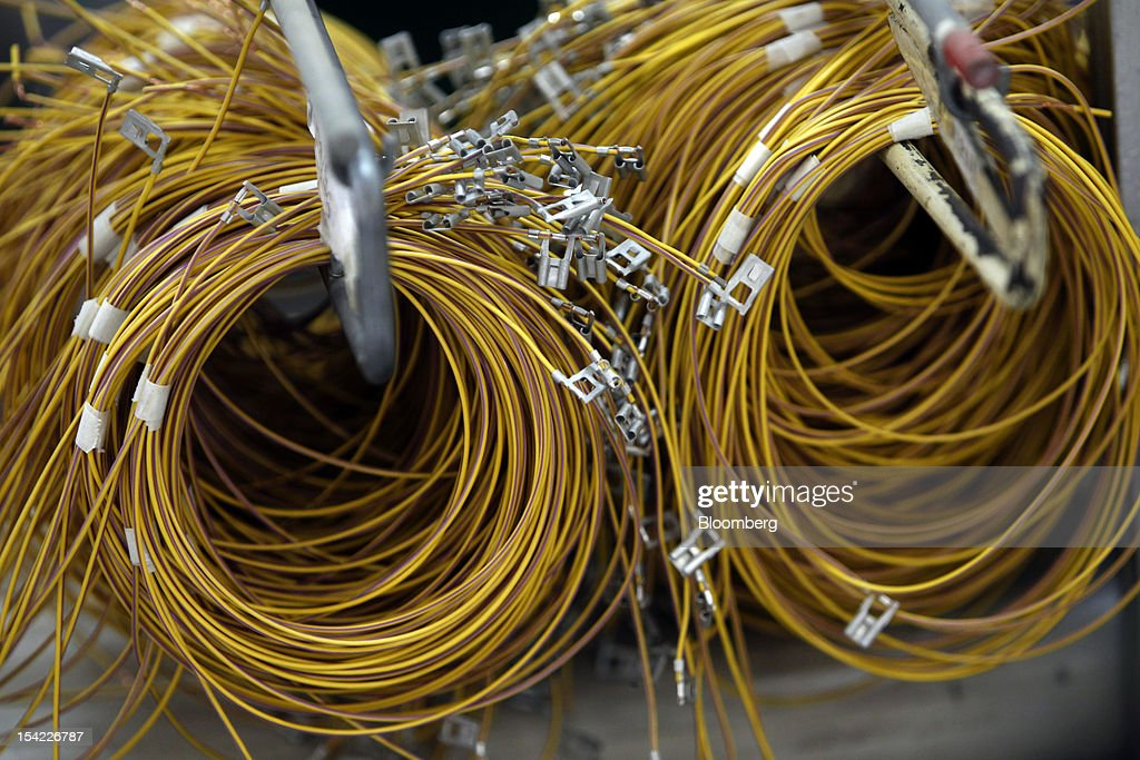rolls of electric cables are readied for harnessing at pkc group oyjs picture id154226787 inside pkc electrical systems manufacturing facilities as brazil's pkc wire harness at readyjetset.co