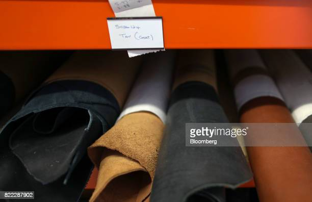 Rolls of goat hide sit on racking in the store room at the Alfred Dunhill Ltd London Leather Workshop in London UK on Tuesday July 25 2017 Alfred...