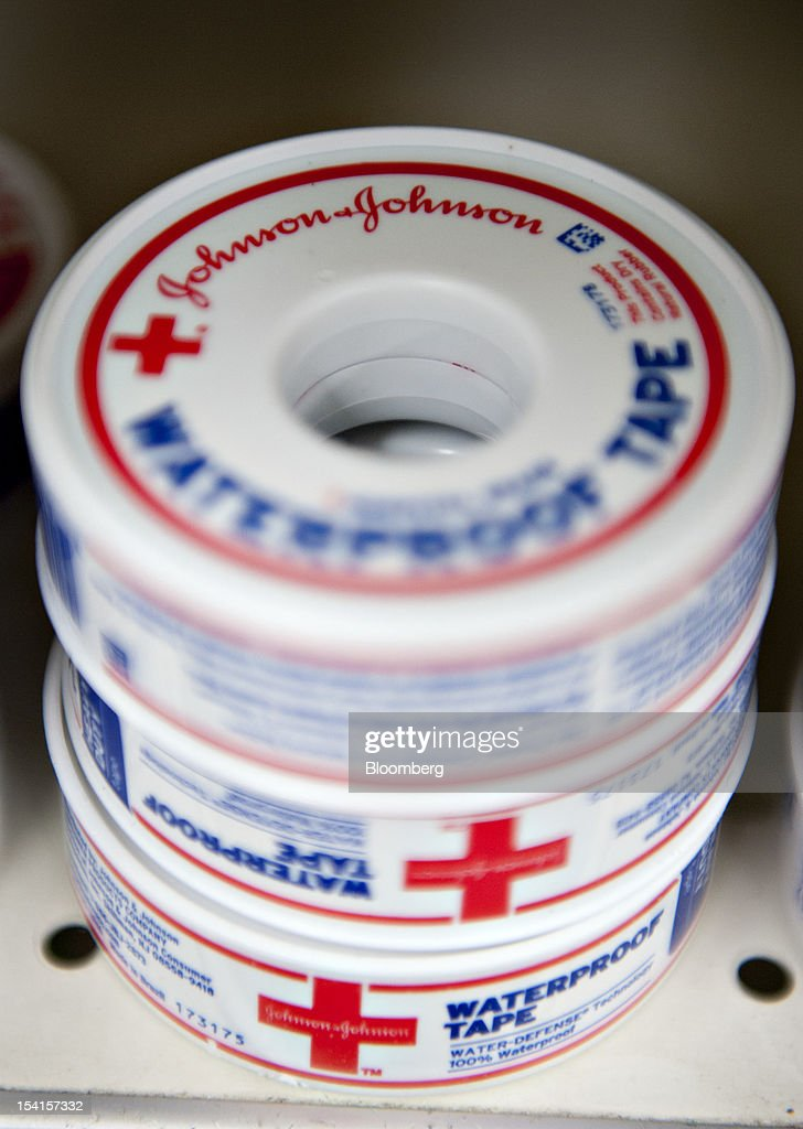 Rolls of Johnson & Johnson waterproof medical tape sit on display in a supermarket in Princeton, Illinois, U.S., on Friday, Oct. 12, 2012. Johnson & Johnson is scheduled to release earnings data on Oct. 16. Photographer: Daniel Acker/Bloomberg via Getty Images