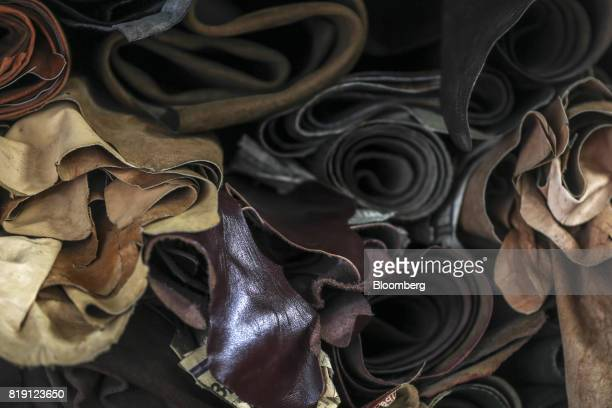 Rolls of leather sit stacked at the Heera Enterprises leather store in the Dharavi area of Mumbai India on Tuesday July 18 2017 India's new goods and...