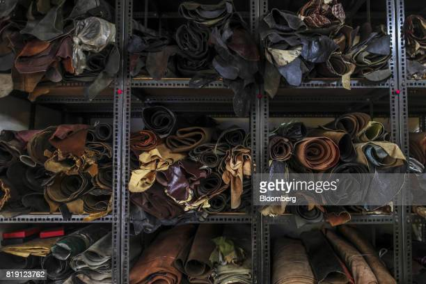 Rolls of leather sit stacked on shelves at the Heera Enterprises leather store in the Dharavi area of Mumbai India on Tuesday July 18 2017 India's...