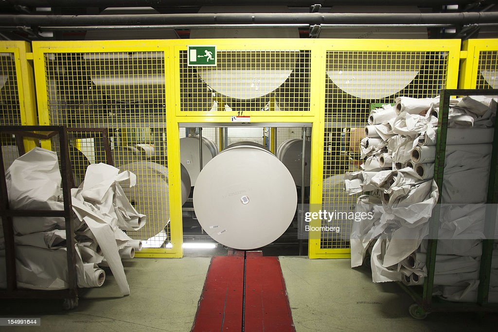 Rolls of newsprint paper sit in a warehouse at the El Pais printing plant in Madrid, Spain, on Tuesday, Oct. 30, 2012. Prisa, the publisher of El Pais newspaper, has announced staff reductions and salary cuts. Photographer: Angel Navarrete/Bloomberg via Getty Images