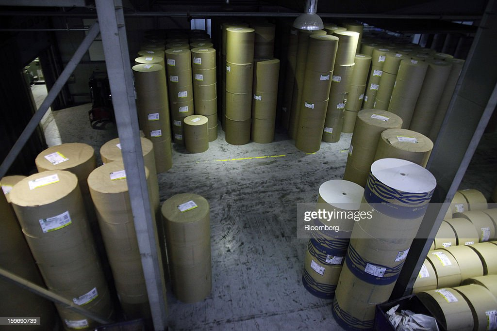 Rolls of newsprint paper stand in a storeroom before use at the Kathimerini printing plant in Paiania, Greece, on Thursday, Jan. 17, 2013. An anarchist group claimed responsibility for a series of attacks early on Jan. 11 when unidentified perpetrators threw makeshift bombs made from propane gas canisters into the homes of five Greek journalists working for national media saying it was to protest coverage of the country's financial crisis seen as sympathetic to the government. Photographer: Kostas Tsironis/Bloomberg via Getty Images