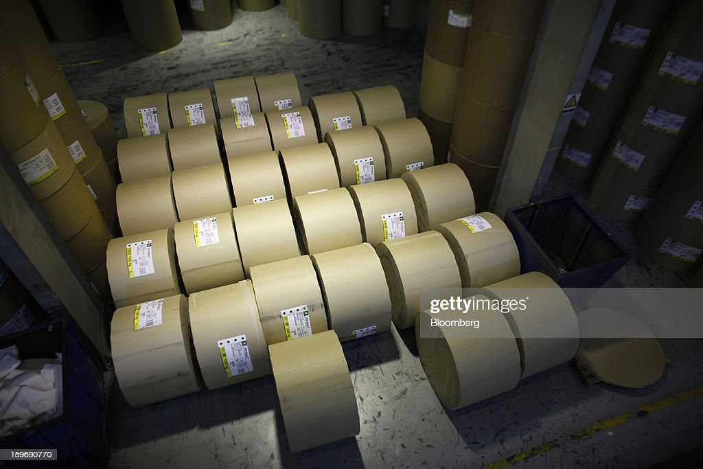 Rolls of newsprint paper stand in a warehouse before use at the Kathimerini printing plant in Paiania, Greece, on Thursday, Jan. 17, 2013. An anarchist group claimed responsibility for a series of attacks early on Jan. 11 when unidentified perpetrators threw makeshift bombs made from propane gas canisters into the homes of five Greek journalists working for national media saying it was to protest coverage of the country's financial crisis seen as sympathetic to the government. Photographer: Kostas Tsironis/Bloomberg via Getty Images