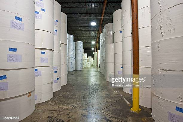 Rolls of paper stored in a warehouse