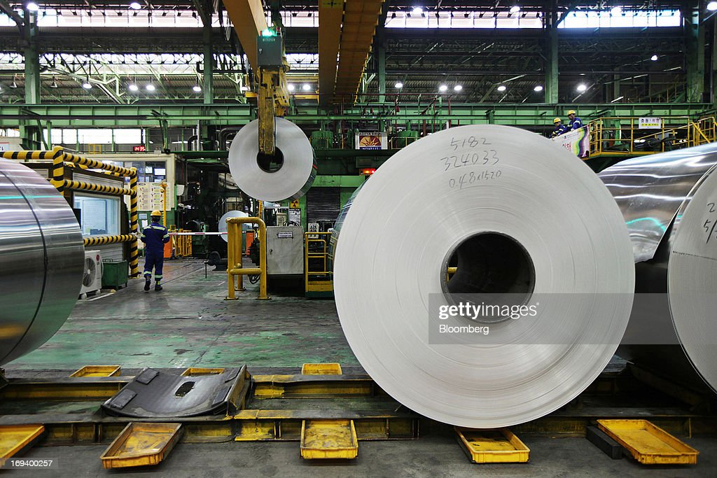 Rolls of sheet aluminum sit stored ahead of cold rolling at Novelis Inc. production facility in Yeongju, South Korea, on Thursday, May 23, 2013. Novelis plans to boost research and development staff by 40 percent as the biggest supplier of flat-rolled aluminum products to global carmakers seeks to increase recycled content in products used in cans and vehicles. Photographer: Woohae Cho/Bloomberg via Getty Images