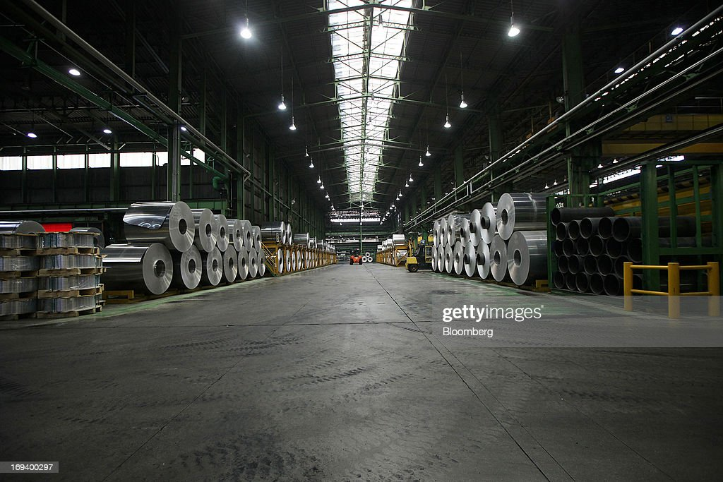 Rolls of sheet aluminum sit stored ahead of cold rolling at the Novelis Inc. production facility in Yeongju, South Korea, on Thursday, May 23, 2013. Novelis plans to boost research and development staff by 40 percent as the biggest supplier of flat-rolled aluminum products to global carmakers seeks to increase recycled content in products used in cans and vehicles. Photographer: Woohae Cho/Bloomberg via Getty Images