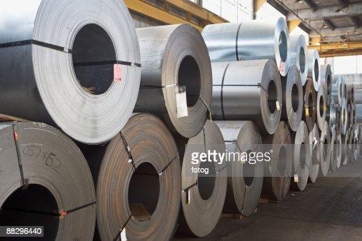 Rolls of steel in warehouse