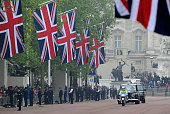 Rolls Royce carrying Catherine Middleton and her father Michael Middleton passes Buckingham Palace as it travels from The Goring Hotel down The Mall...