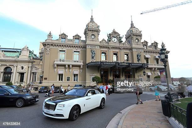 A RollsRoyce automobile produced by RollsRoyce Motor Cars Ltd drives in front of the Casino de MonteCarlo in Monaco on Monday June 8 2015 The Monaco...