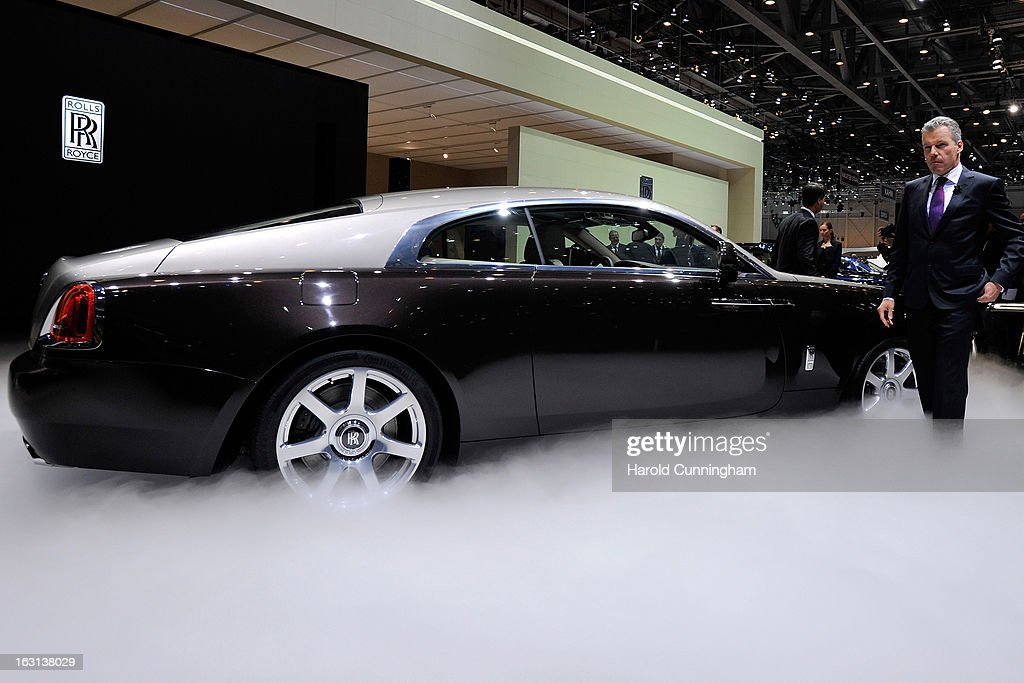 Rolls-Royce CEO Torsten Mueller-Oetvoes looks on as the Wraith is unveiled in world premiere during the 83rd Geneva Motor Show on March 5, 2013 in Geneva, Switzerland. Held annually the Geneva Motor Show is one of the world's five most important auto shows with this year's event due to unveil more than 130 new products.