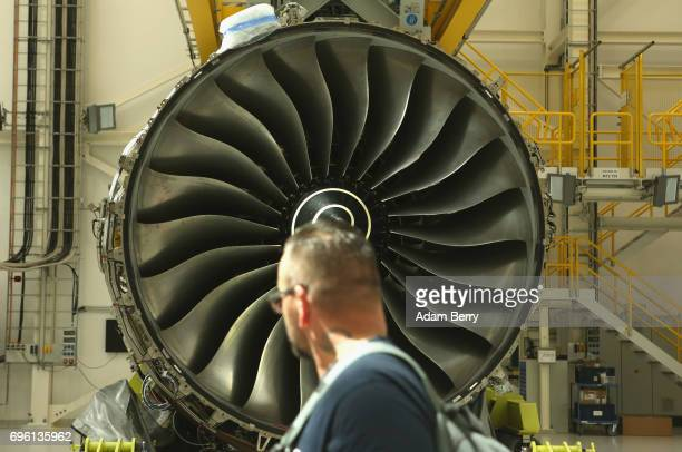 RollsRoyce employee passes a RollsRoyce Trent XWB airplane engine to be used in the Airbus A350 XWB aircraft on June 14 2017 in Berlin Germany The...