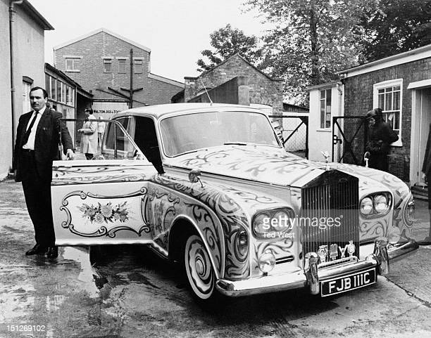 A RollsRoyce Phantom V with custom psychedelic paintwork owned by John Lennon of The Beatles Chertsey Surrey 25th May 1967 The car is bright yellow...