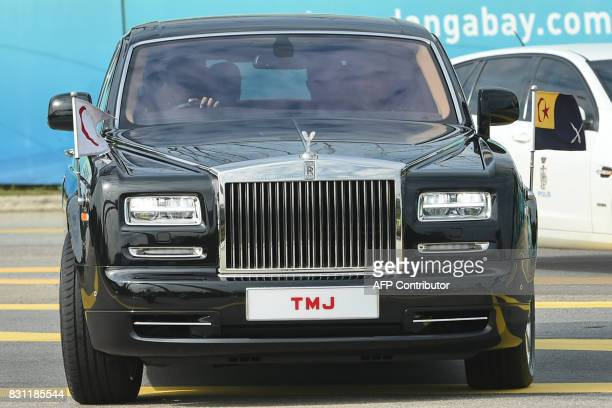 A RollsRoyce transporting the Crown Prince of Johor enters the Istana Bukit Serene palace in Johor Bahru on August 14 for the wedding of Princess...