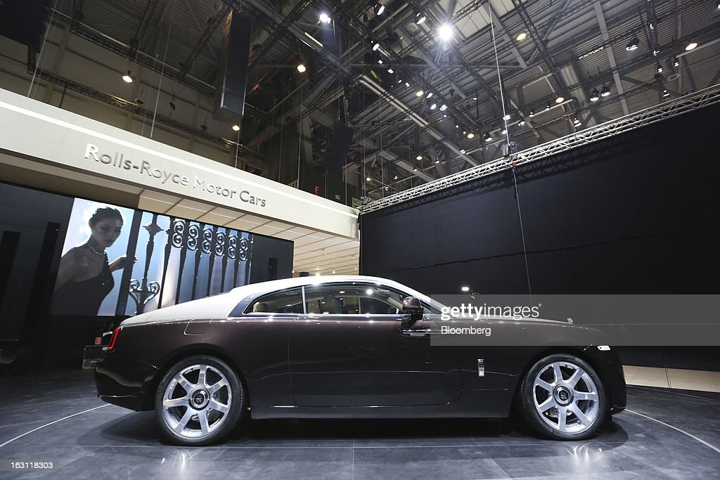 A Rolls-Royce Wraith automobile, produced by Rolls-Royce Motor Cars Ltd., sits on the company's stand ahead of the opening day of the 83rd Geneva International Motor Show in Geneva, Switzerland, on Monday, March 4, 2013. This year's show opens to the public on Mar. 7, and is set to feature more than 100 product premiers from the world's automobile manufacturers. Photographer: Chris Ratcliffe/Bloomberg via Getty Images