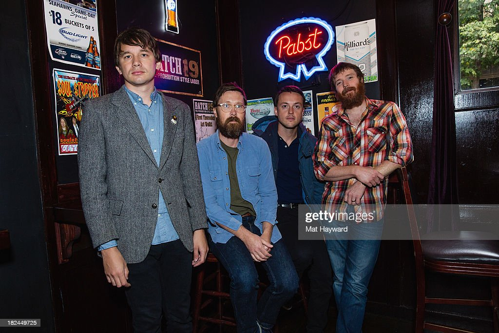 Rollum Haas, Matt Pelham, Mark Bond and Roger Dabbs of the Features pose backstage before performing an EndSession hosted by 107.7 The End at the J&M Cafe on September 29, 2013 in Seattle, Washington.