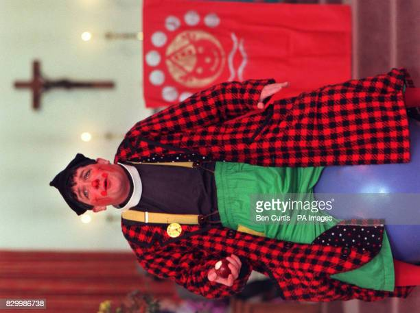 Roly Bain priest and clown gives a sermon at the the 52nd Annual Grimaldi church service for clowns at the Holy Trinity with St Philip church in...