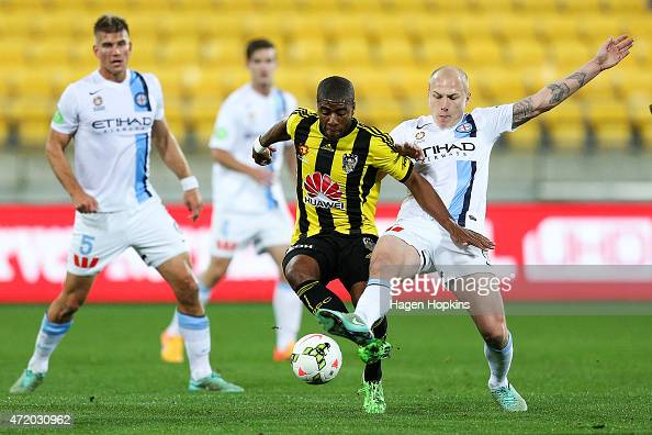 Roly Bonevacia of the Phoenix and Aaron Mooy of Melbourne City compete for the ball during the ALeague Elimination match between the Wellington...