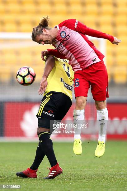 Roly Bonevacia of the Phoenix and Luke Brattan of Melbourne City compete for a header during the round 20 ALeague match between the Wellington...