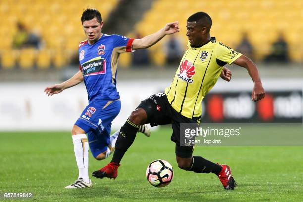 Roly Bonevacia of the Phoenix avoids the defense of Wayne Brown of the Jets during the round 24 ALeague match between Wellington Phoenix and...