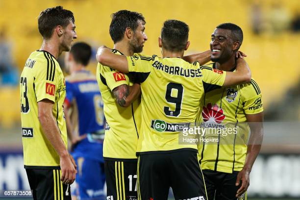 Roly Bonevacia of the Phoenix celebrates his goal with teammates Kosta Barbarouses Vince Lia and Matthew Ridenton during the round 24 ALeague match...