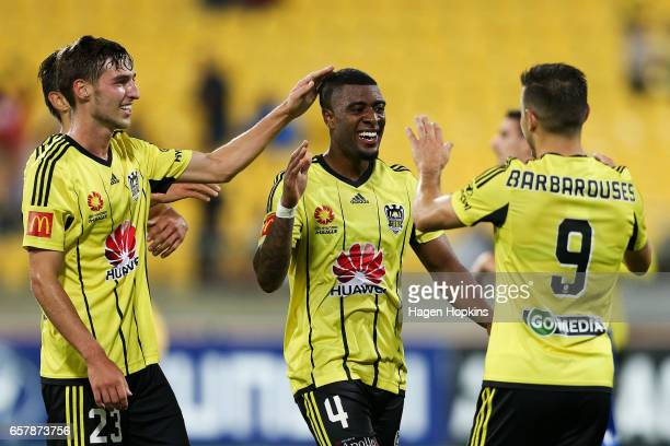 Roly Bonevacia of the Phoenix celebrates his goal with teammates Kosta Barbarouses and Matthew Ridenton during the round 24 ALeague match between...