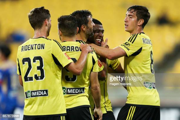 Roly Bonevacia of the Phoenix celebrates his goal with teammates Kosta Barbarouses Vince Lia Matthew Ridenton and Alex Rodriguez during the round 24...