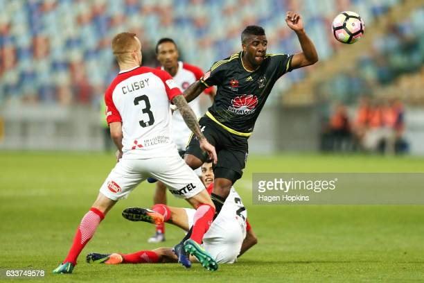 Roly Bonevacia of the Phoenix competes for the ball with Jack Clisby of the Wanderers during the round 18 ALeague match between the Wellington...