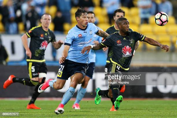 Roly Bonevacia of the Phoenix controls the ball under pressure from Filip Holosko of Sydney FC during the round 26 ALeague match between the...
