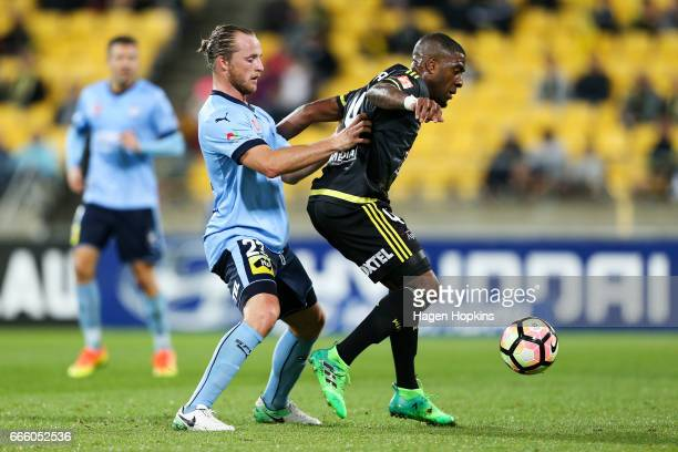 Roly Bonevacia of the Phoenix holds off the challenge of Rhyan Grant of Sydney FC during the round 26 ALeague match between the Wellington Phoenix...