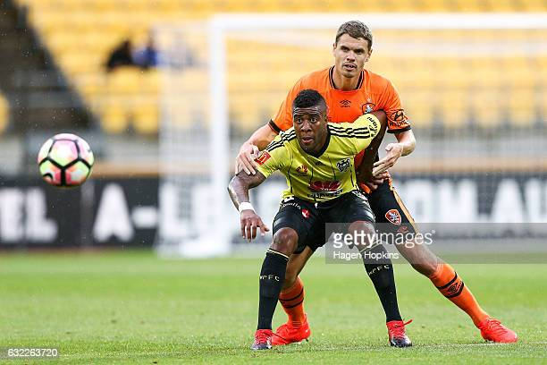 Roly Bonevacia of the Phoenix holds off the challenge of Thomas Kristensen of the Roar during the round 16 ALeague match between the Wellington...