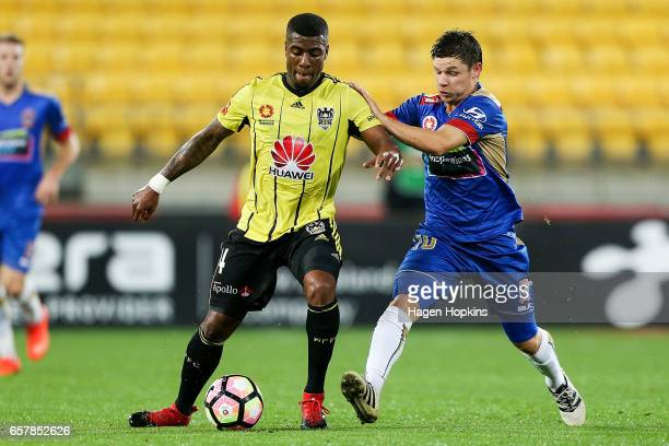 Roly Bonevacia of the Phoenix is challenged by Wayne Brown of the Jets during the round 24 ALeague match between Wellington Phoenix and Newcastle...