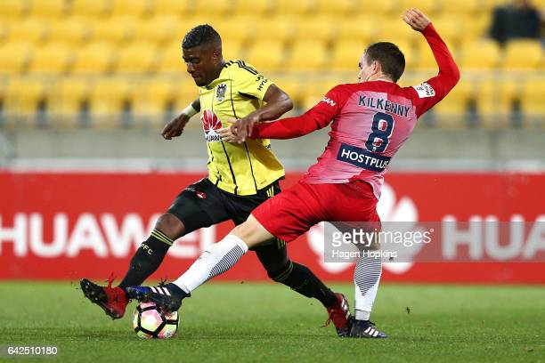 Roly Bonevacia of the Phoenix is tackled by Neil Kilkenny of Melbourne City during the round 20 ALeague match between the Wellington Phoenix and...