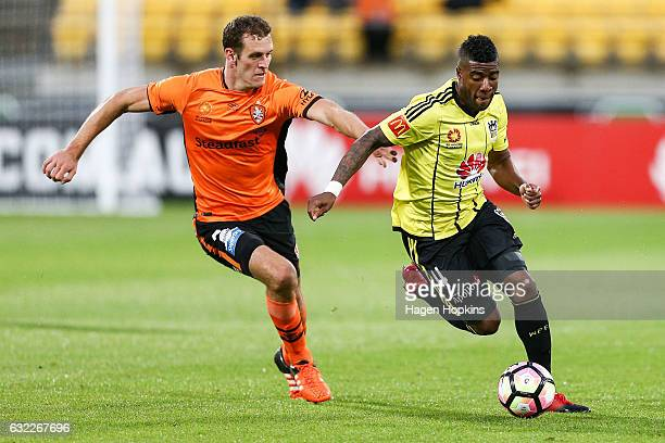 Roly Bonevacia of the Phoenix makes a break from Luke DeVere of the Roar during the round 16 ALeague match between the Wellington Phoenix and the...