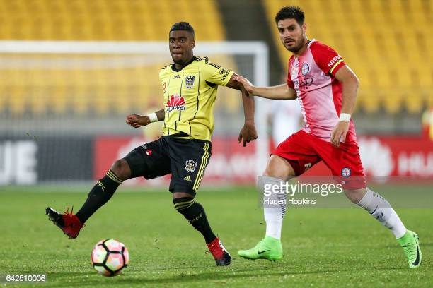 Roly Bonevacia of the Phoenix passes under pressure from Bruno Fornaroli of Melbourne City during the round 20 ALeague match between the Wellington...