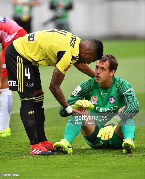 Roly Bonevacia of Wellington Phoenix and Thomas Sorensen goal keeper for Melbourne City during the round 20 ALeague match between the Wellington and...