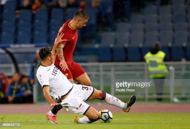 Roma Aleksandar Kolarov right is fouled by Crotone Rolando Mandragora during the Serie A soccer match between Roma and Crotone at the Olympic stadium