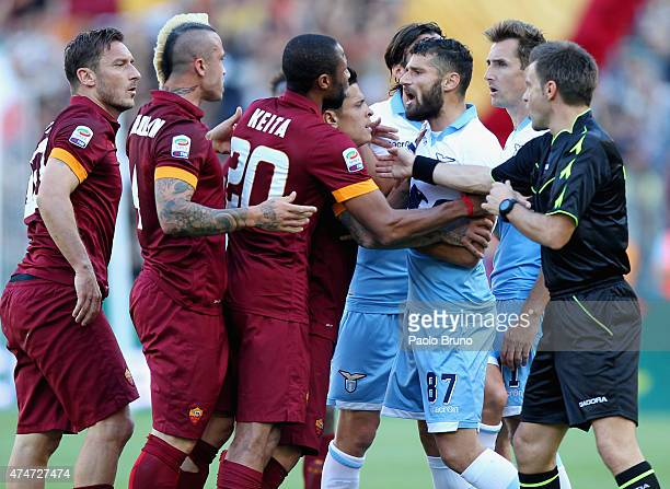 Roma and SS Lazio players argue during the Serie A match between SS Lazio and AS Roma at Stadio Olimpico on May 25 2015 in Rome Italy