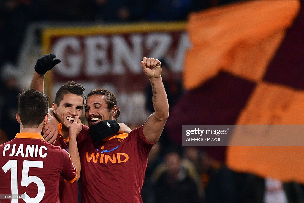 AS Roma Argentine forward Erik Lamela C celebrates after scoring with teammates AS Roma Argentine forward Pablo Daniel Osvaldo R and AS Roma Bosnian midfielder Miralem Pjanic L during the Italian Serie A football match between AS Roma and AC Milan on December 22, 2012, at the Olympic stadium in Rome.