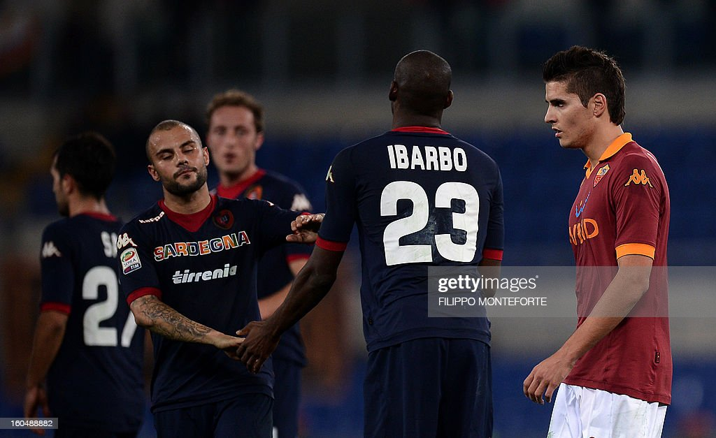AS Roma Argentine forward Erik Lamela (R) reacts against Cagliari after losing 4-2during the Serie A football match AS Roma vs Cagliari in Rome's Olympic Stadium on Febuary 1, 2013.