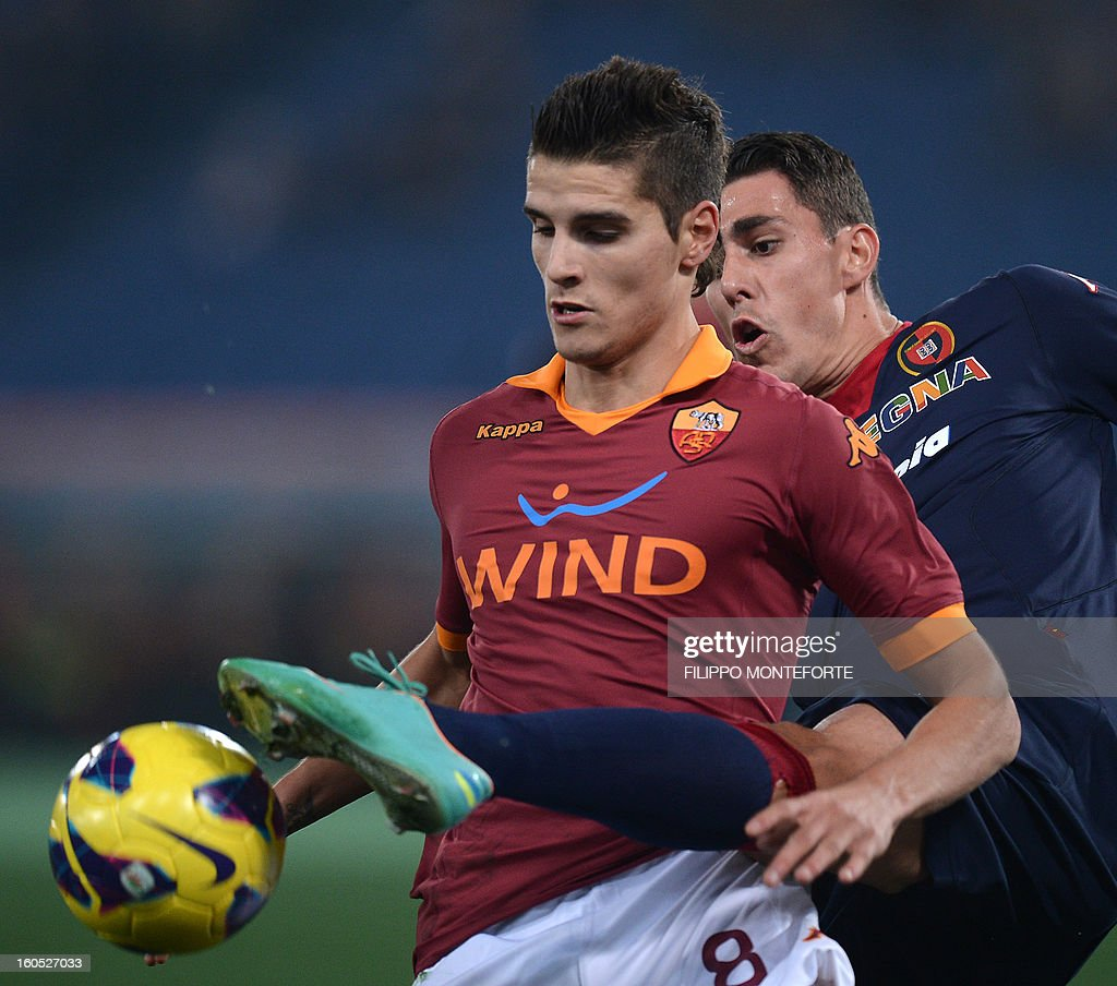 AS Roma Argentine forward Erik Lamela (L) vies with Cagliari's Brazilian defender Danilo Fernando Avelar during the Serie A football match AS Roma vs Cagliari in Rome's Olympic Stadium on Febuary 1, 2013.