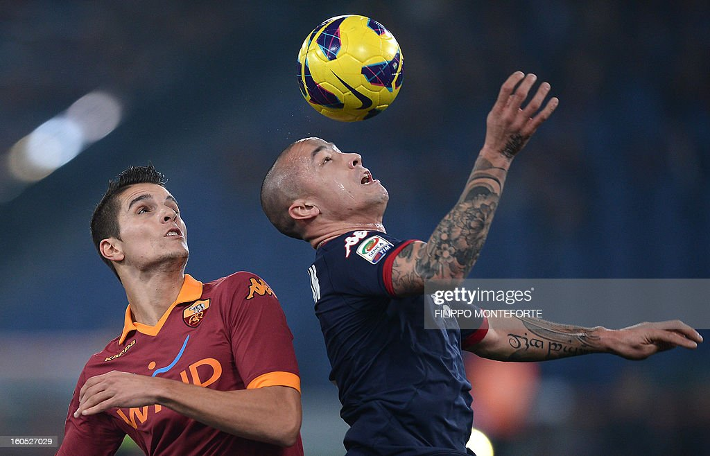 AS Roma Argentine forward Erik Lamela (L) vies with Cagliari's midfielder Radja Nainggolan during the Serie A football match AS Roma vs Cagliari in Rome's Olympic Stadium on Febuary 1, 2013.