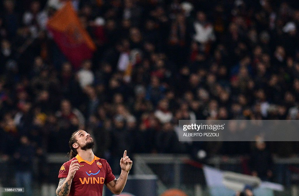 AS Roma Argentine forward Pablo Daniel Osvaldo celebrates after scoring during the Italian Serie A football match between As Roma and Ac Milan on December 22 , 2012 at the Olympic stadium in Rome.