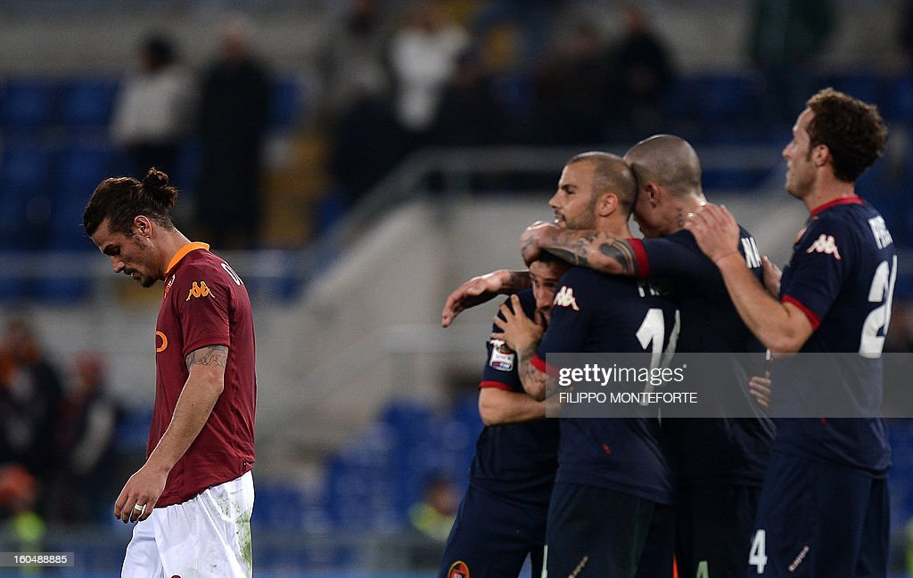 AS Roma Argentine forward Pablo Daniel Osvaldo (L) reacts against Cagliari after losing 4-2during the Serie A football match AS Roma vs Cagliari in Rome's Olympic Stadium on Febuary 1, 2013.