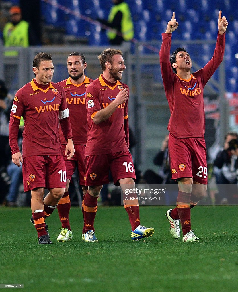 AS Roma Argentinean defender Nicolas Andres Burdisso (R) celebrates after scoring a goal during the Italian Serie A football match between AS Roma and AC Milan on December 22, 2012, at the Olympic stadium in Rome.