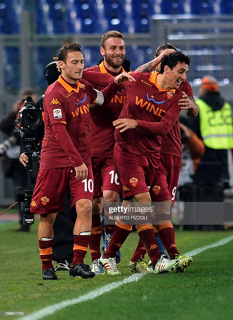 AS Roma Argentinean defender Nicolas Andres Burdisso (R) celebrates after scoring a goal during the Italian Serie A football match between AS Roma and AC Milan on December 22, 2012, at the Olympic stadium in Rome. AFP PHOTO / ALBERTO PIZZOLI