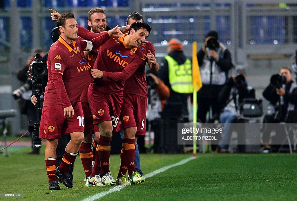 AS Roma Argentinean defender Nicolas Andres Burdisso (3rd L) celebrates with teammates after scoring a goal during the Italian Serie A football match between AS Roma and AC Milan on December 22, 2012, at the Olympic stadium in Rome.