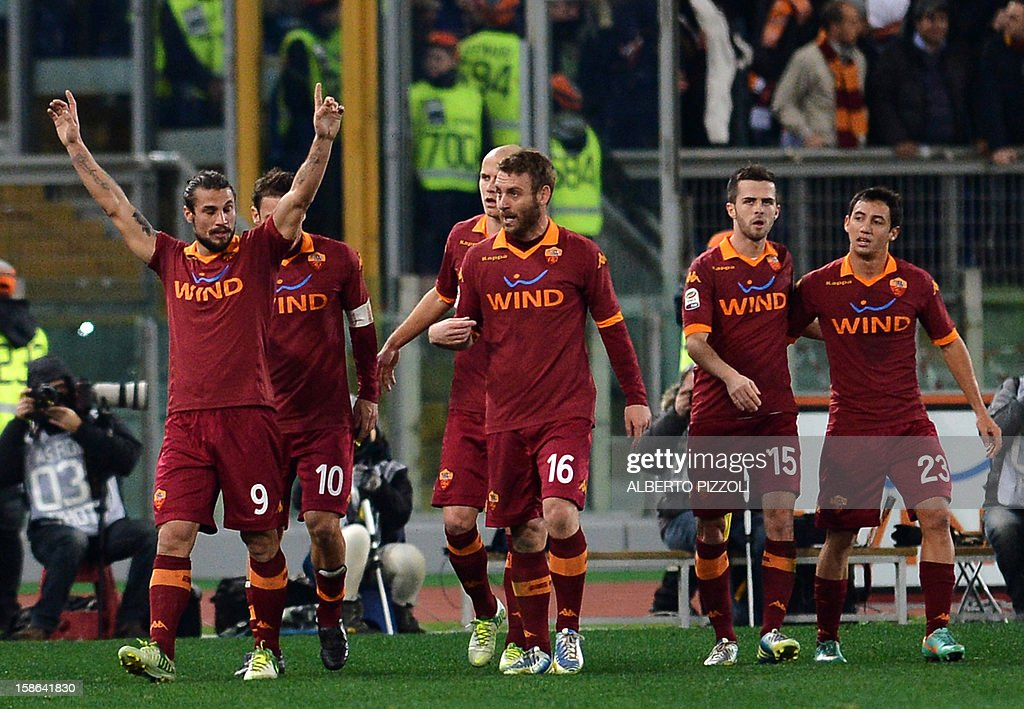 AS Roma Argentinean forward Pablo Daniel Osvaldo (L) celebrates after scoring a goal during the Italian Serie A football match between AS Roma and AC Milan on December 22, 2012, at the Olympic stadium in Rome.