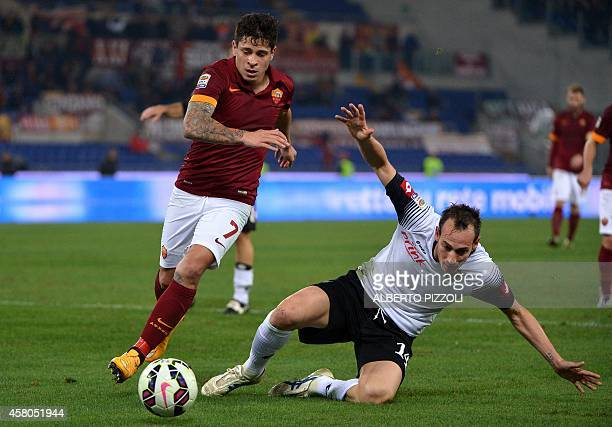 AS Roma Argentinian forward Juan Manuel Iturbe fights for the ball with Cesena's defender Massimo Volta during the Italian Serie A football match As...