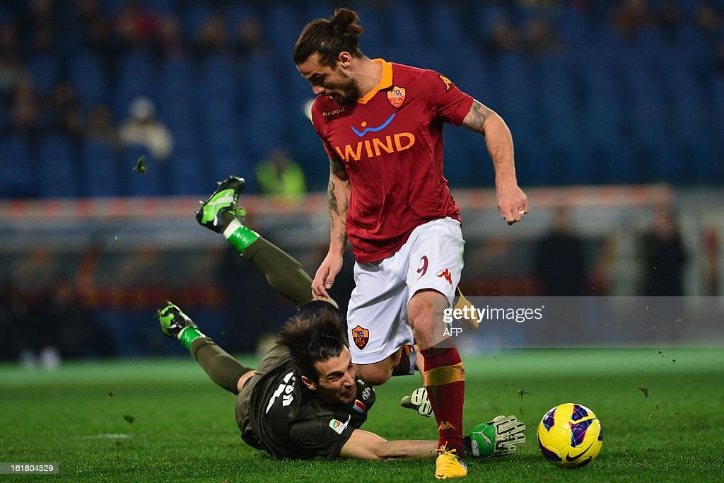 AS Roma Argentinian forward Pablo Daniel Osvaldo fights for the ball with Juventus' goalkeeper Gianluigi Buffon during the Italian Serie A football match between AS Roma and Juventus on February 16, 2013 at the Olympic Stadium in Rome.